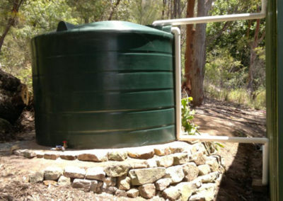 11000L round tank beside rural shed in heritage green