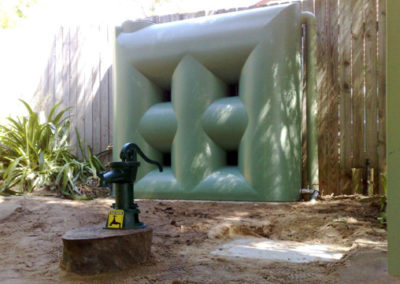 2000L slimline tank and feature hand pump in mist green